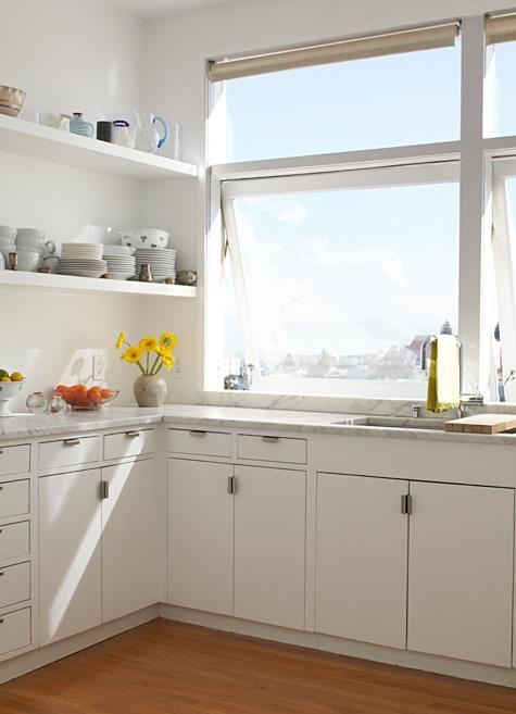 white cabinets, marble countertops