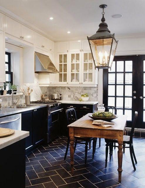 Traditional black & white kitchen with farmhouse table